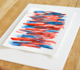 Blue and red abstract painting on paper