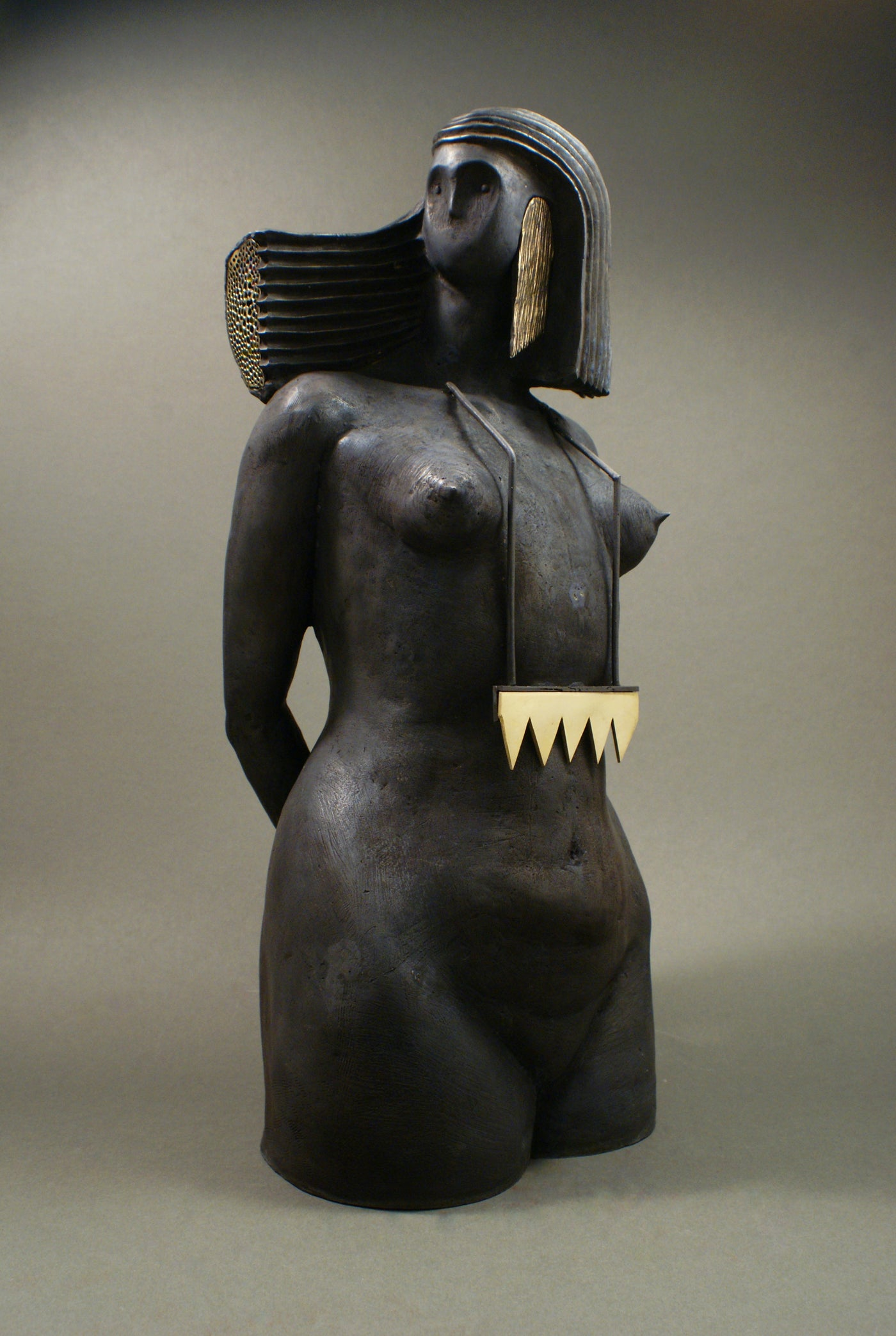 Bronze sculpture of a woman