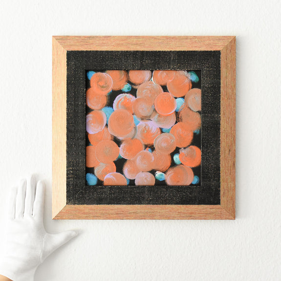 Orange framed abstract painting
