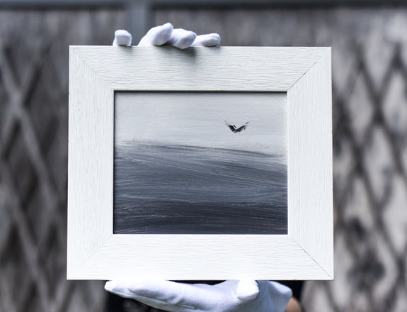 Small framed black and white painting