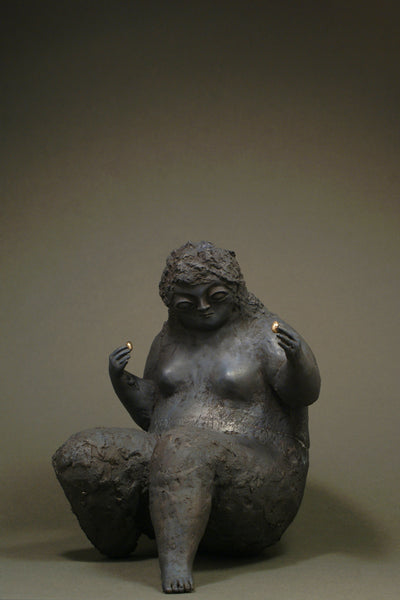 Bronze sculpture of a woman for sale