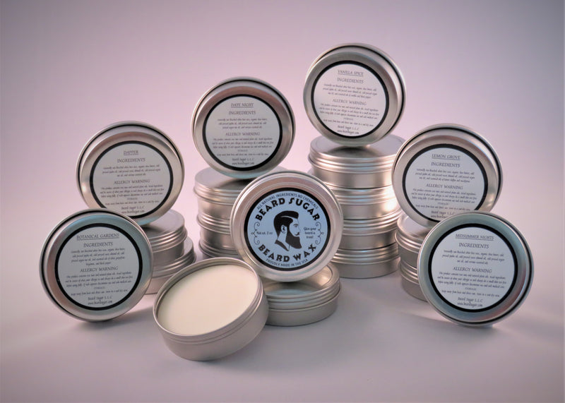 Scented beard wax screw top tins.