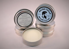 Scented beard balm screw top tins.