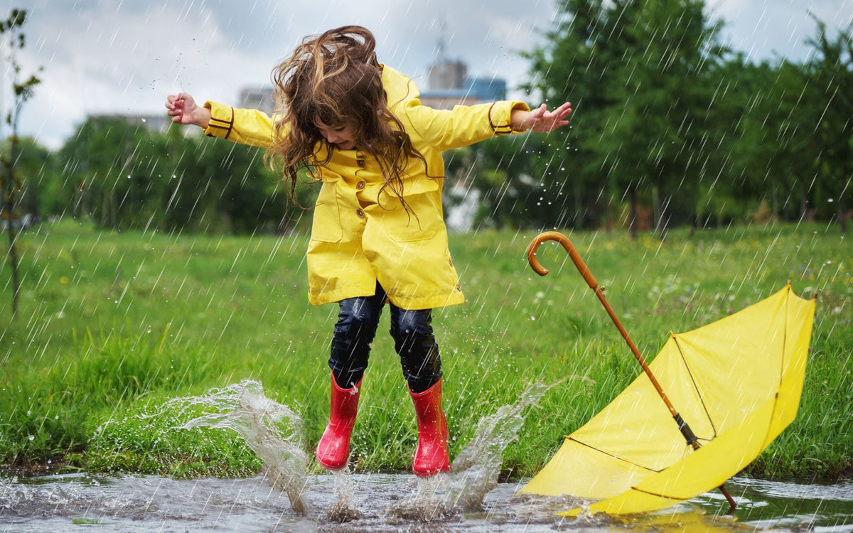 playing in the rain, kids playing in the rain, rainy day play, rainy day fun