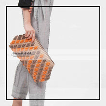 Load image into Gallery viewer, ANTONELLO TEDDE piatta clutch on model - eco friendly bags