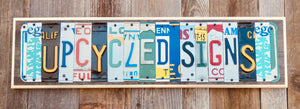 Personalized License Plate Sign repurposed from colorful license plates