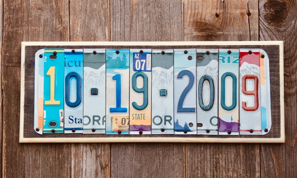 Date License Plate Sign repurposed from colorful license plates