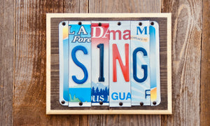 Sing License Plate Sign repurposed from colorful license plates