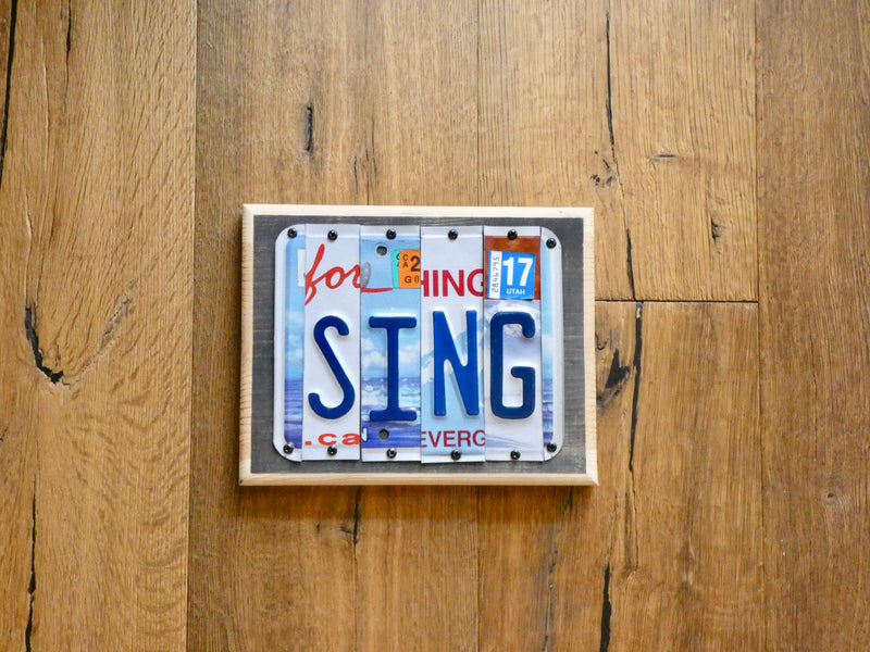 SING Sign made with repurposed License Plates