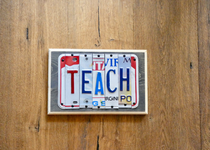 TEACH Sign made with repurposed License Plates