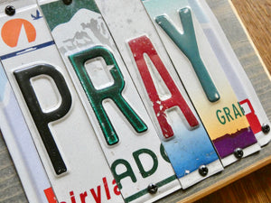 PRAY Sign made with repurposed License Plates