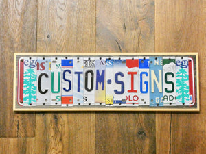 MAN CAVE Sign made with repurposed License Plates