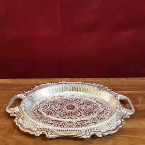 Oval carved plate with handle