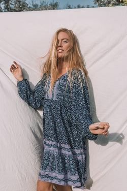 bohemian inspired, long sleeve tunic dress in a navy and purple floral border print. Long sleeves and short skirt length