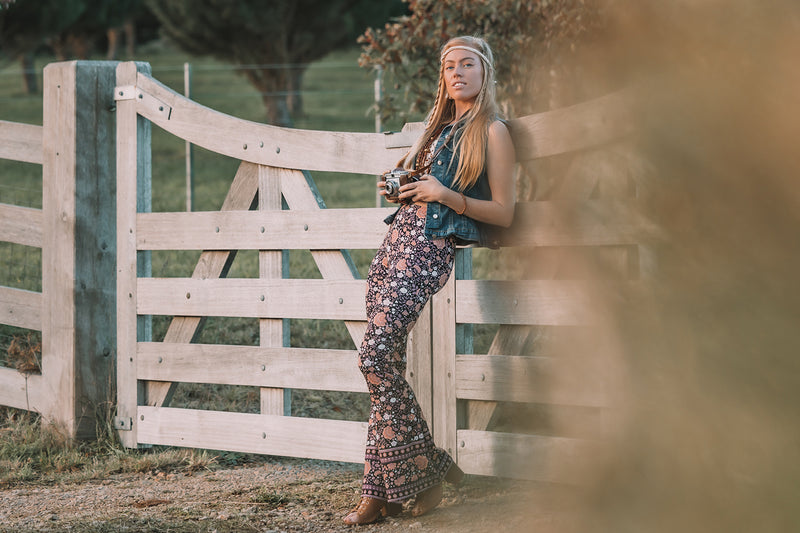 Bohemian inspired, black based floral bell bottoms made from a stretch Jersey fabric, exclusive to We the Wild Collective