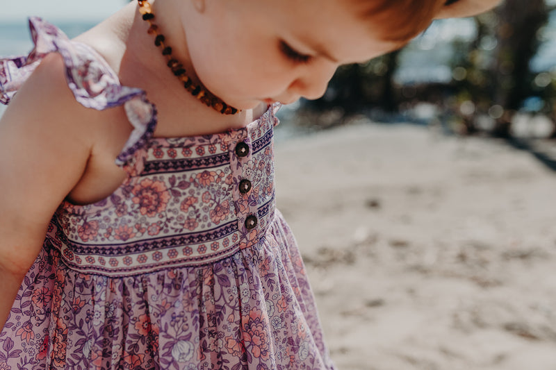 Bohemian style, Kids cotton dress featuring an exclusive placement print in pink, frilled sleeves and coconut buttons. Exclusive to We the Wild Collective