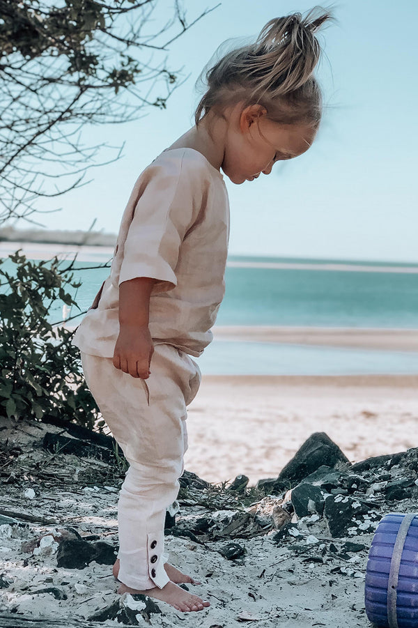 Kids, Bohemian style pant made from pink, 100% linen. Exclusive to We the Wild Collective
