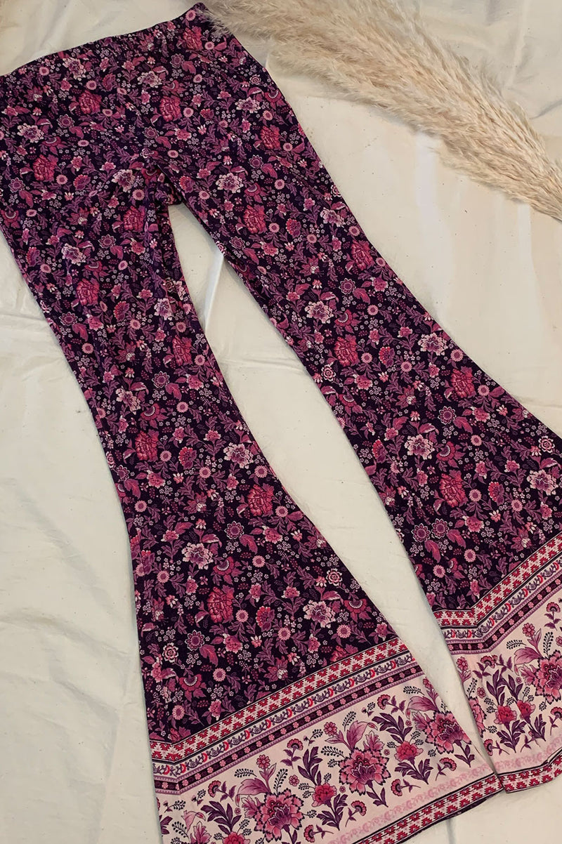 Women's Bohemian style bell bottoms in a purple bohemian border print, exclusive to We the Wild Collective