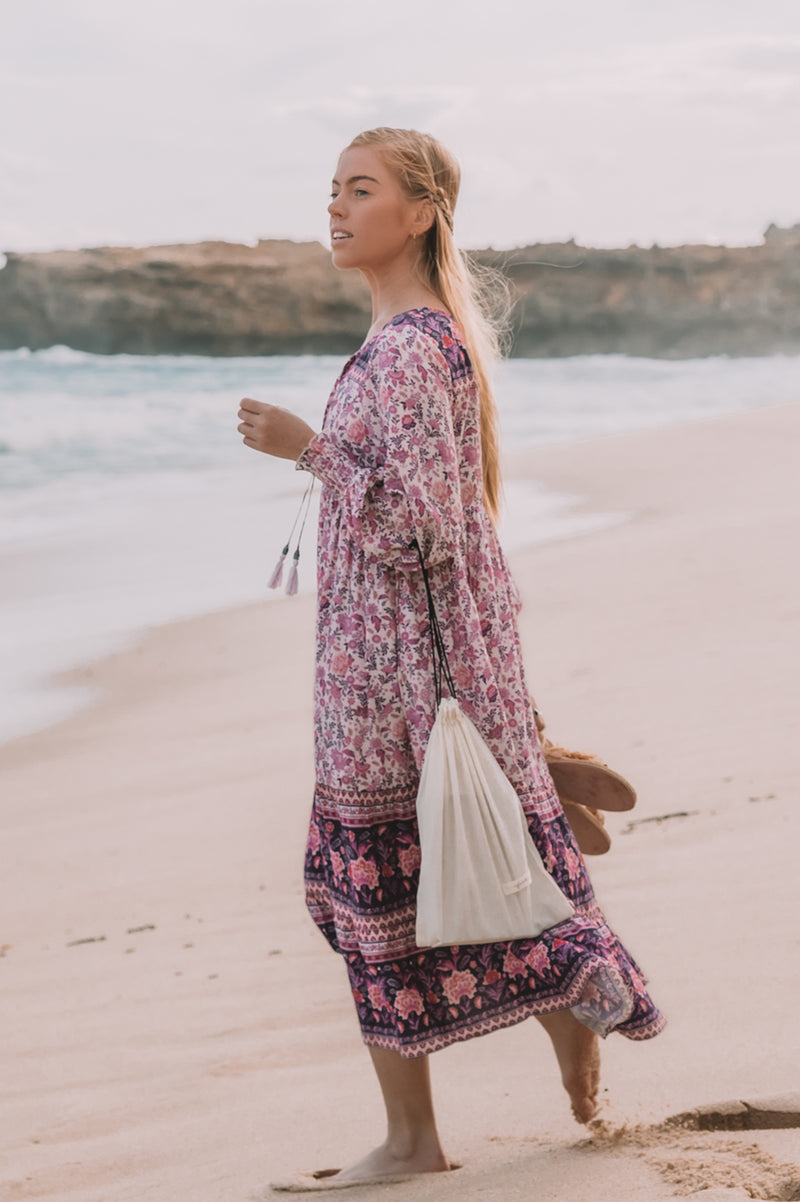 We the Wild Collective, bohemian inspired, long sleeve midi dress with shirred cuffs. Lilac Love print colour.  Fully lined