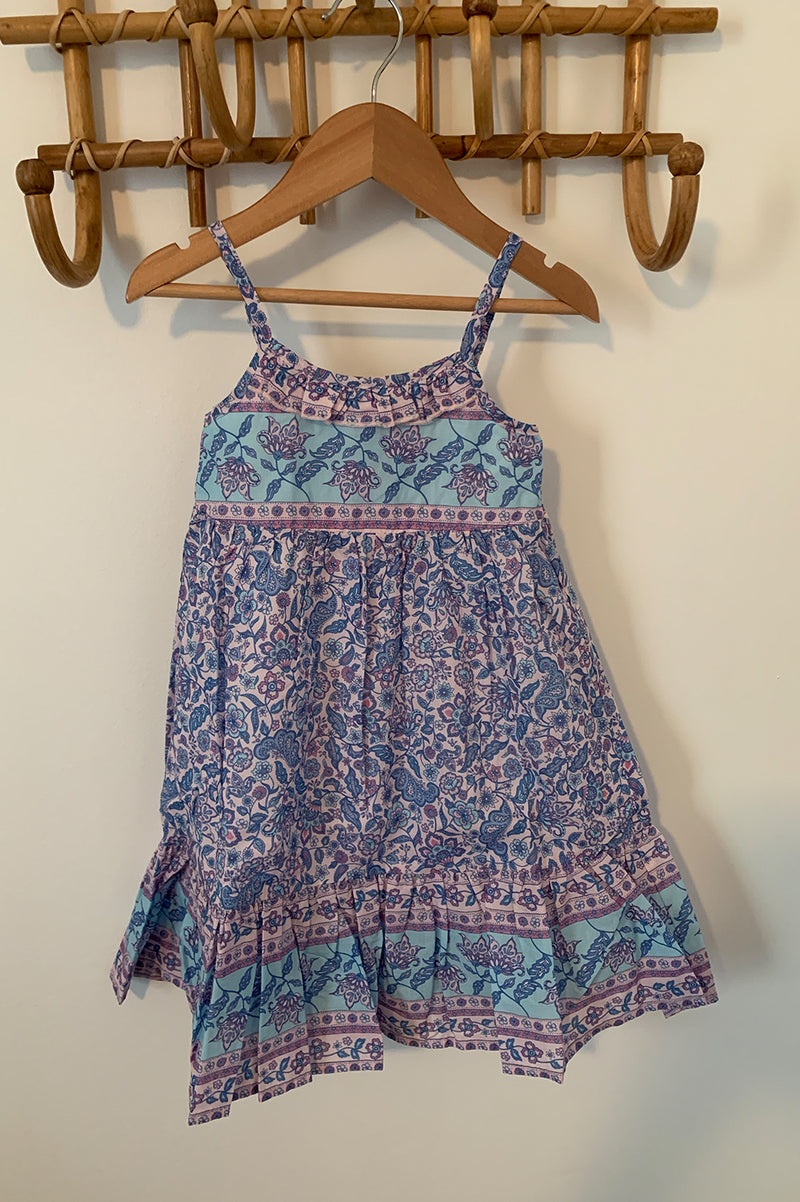 Kids Bohemian Style, midi length dress with shoestring adjustable straps and placement floral print detailing. Purple colour, exclusive to We the Wild Collective