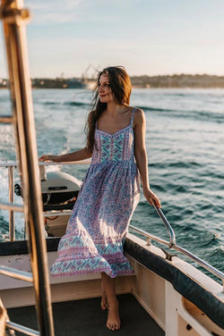 Women's Bohemian Style, midi length dress with shoestring adjustable straps and placement floral print detailing. Purple colour, exclusive to We the Wild Collective
