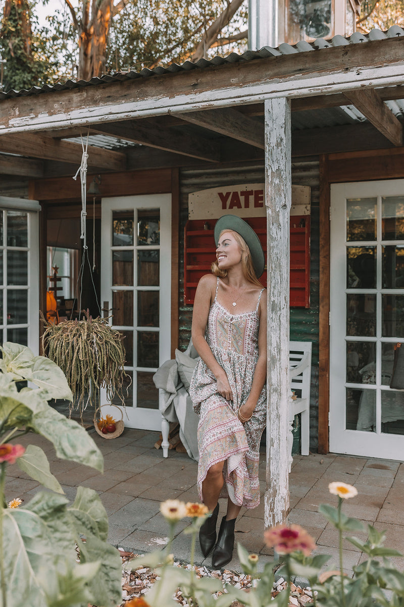 Women's Bohemian Style, midi length dress with shoestring adjustable straps and placement floral print detailing. Ivory colour, exclusive to We the Wild Collective