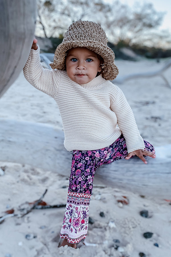 Kids Bohemian style bell bottoms in a purple bohemian border print, exclusive to We the Wild Collective