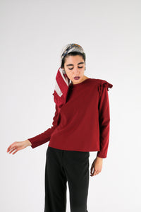 long sleeve blouse with ruffles on the shoulders