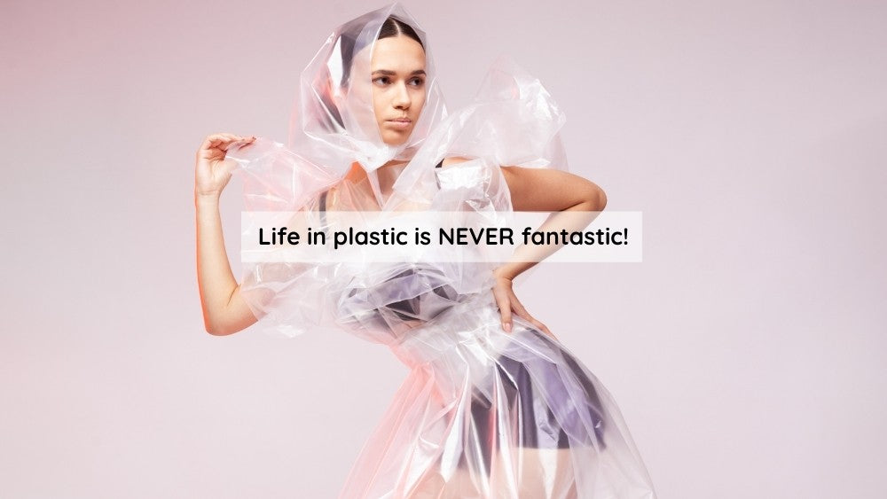 Life in plastic is not fantastic | Woman dressed in plastic outfit
