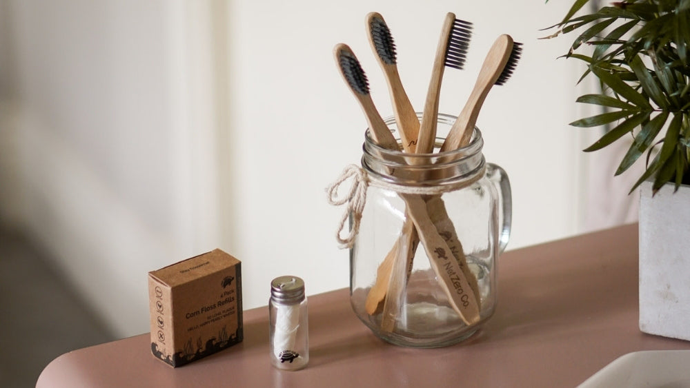 Net Zero Co bamboo toothbrush and corn floss