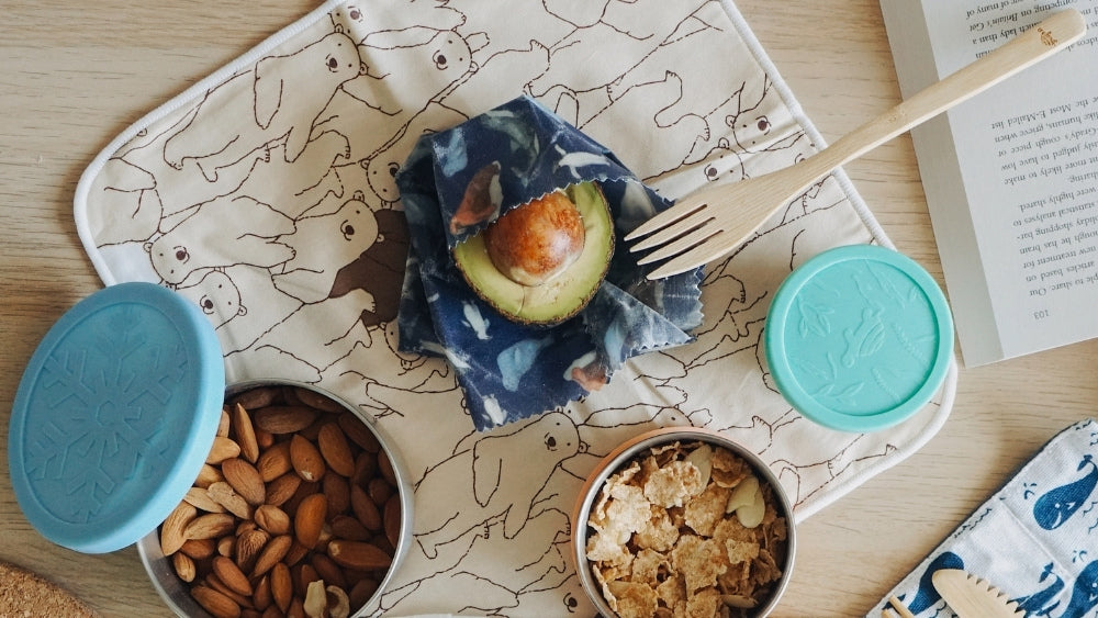 Net Zero beeswax wraps with other food on the table