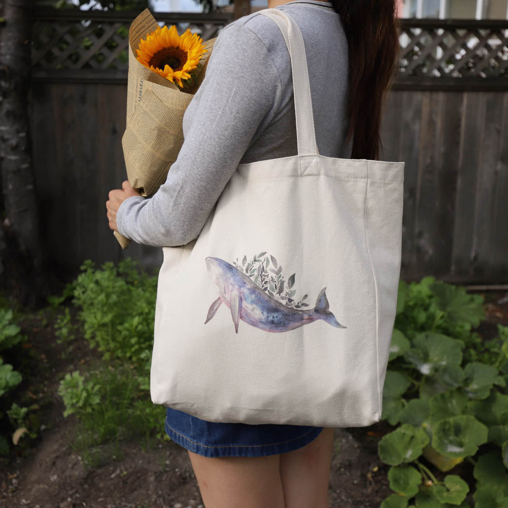 cotton tote bag with pocket lifestyle - whale with leaves