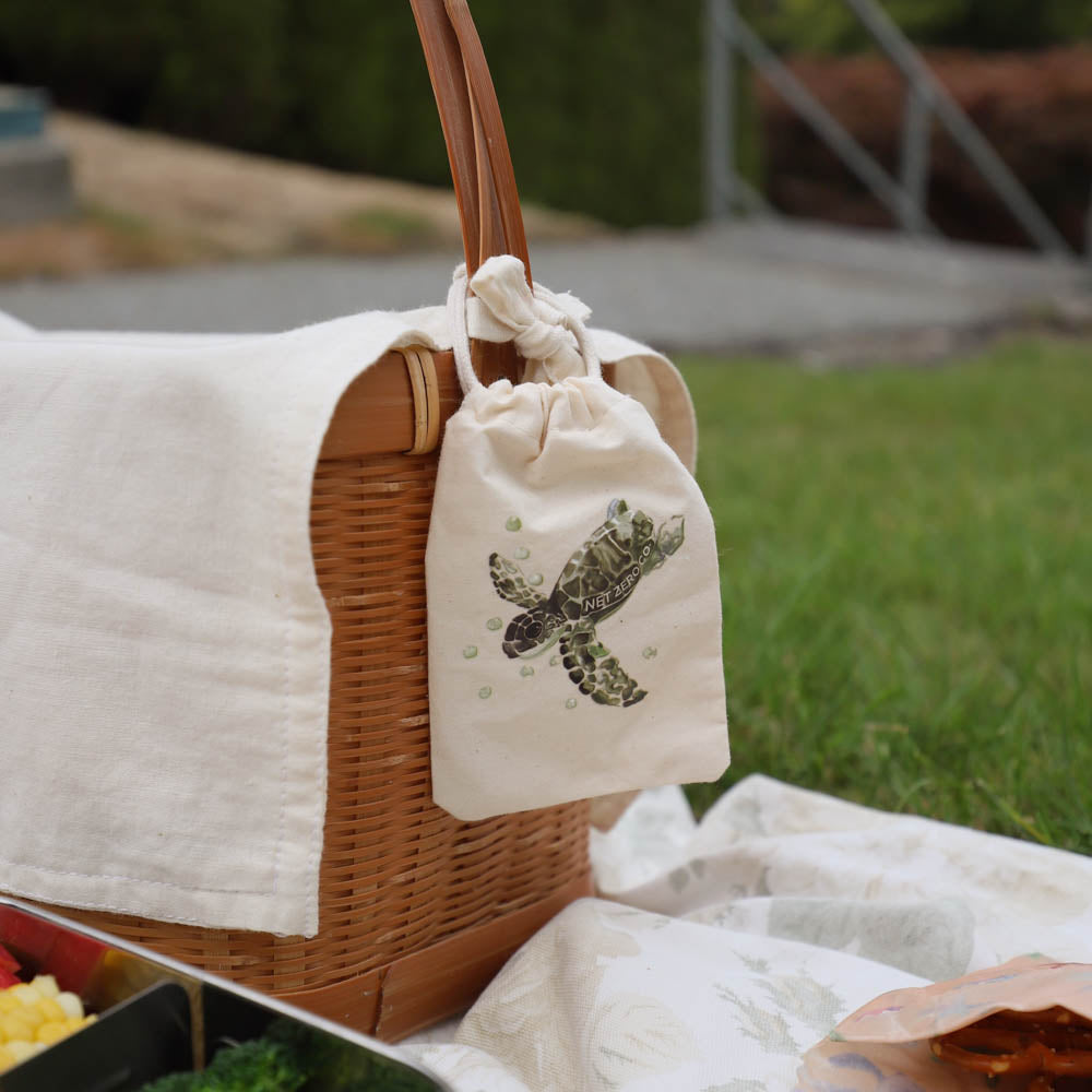 folding spork lifestyle - jute bag with turtle