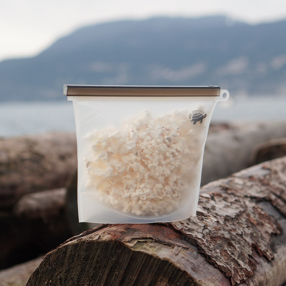 net zero co. large silicone sealer bag with popcorn on beach