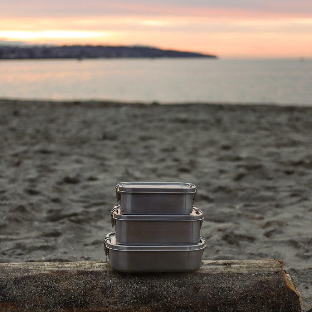 stainless steel lunch box with dividers and leak proof clasp at beach