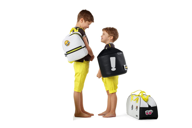 Boy wearing the Sophy kids Ergonomic Drawstring Backpack Yellow.jpg