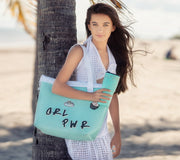 Girl wearing the Wet N Dry Beach Bag Turq Green personalized with DIY nimicks