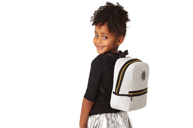 girl wearing the Stark Kids Light Backpack Gold Edition.jpg