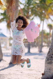 Girl dancing at the beach with her EVA / Silicone Wet N Dry Beach Bag Pink