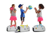 Kids playing ball near their Duffy Kids Ultra Light Travel Bag With Shoe Compartment.jpg