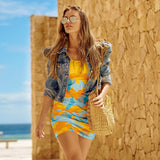 BodyCon Dress in Surf pattern of yellow, orange, and aqua. Model shot.