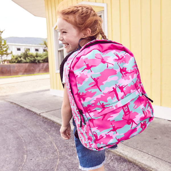 Model wearing Camo Backpack | Ballet | In Pinks and Pale Blue. Front view.