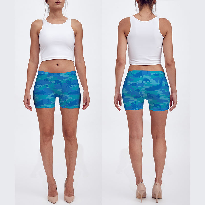 Shorts in blues and aquas. Model shows front and back of our Ocean Camo Shorts.