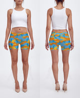 Shorts in yellow, orange, and aqua. Model displays front and back of our Surf Camo.