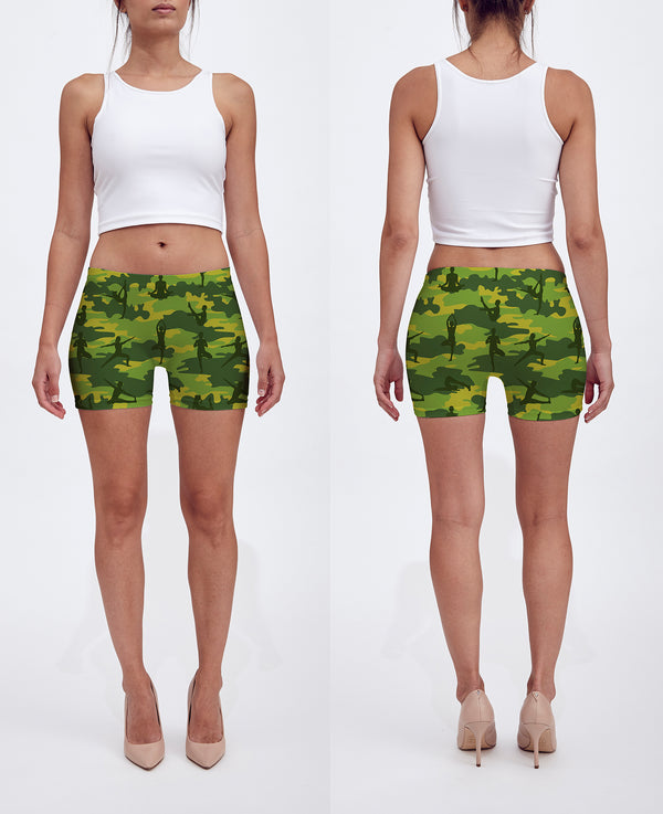 Shorts in tropical greens. Model shows front and back of our Yoga Camo.