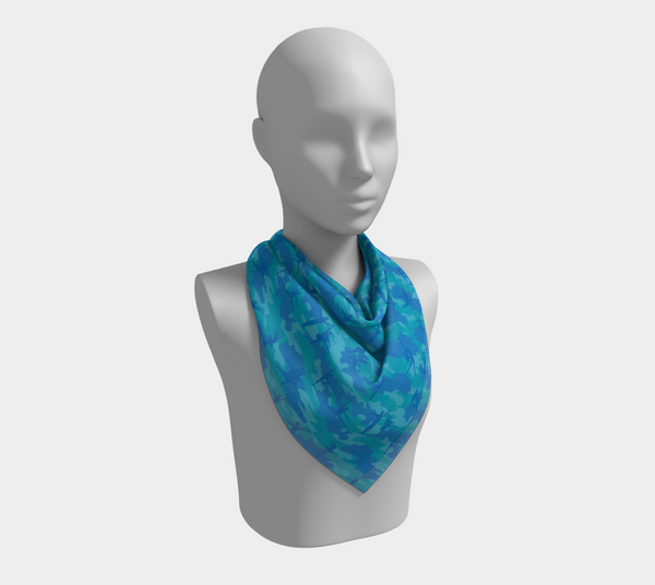 Ballet Camo Scarf | Square | In blues and aquas. This mannikin is wearing the 26x26 inch size scarf.