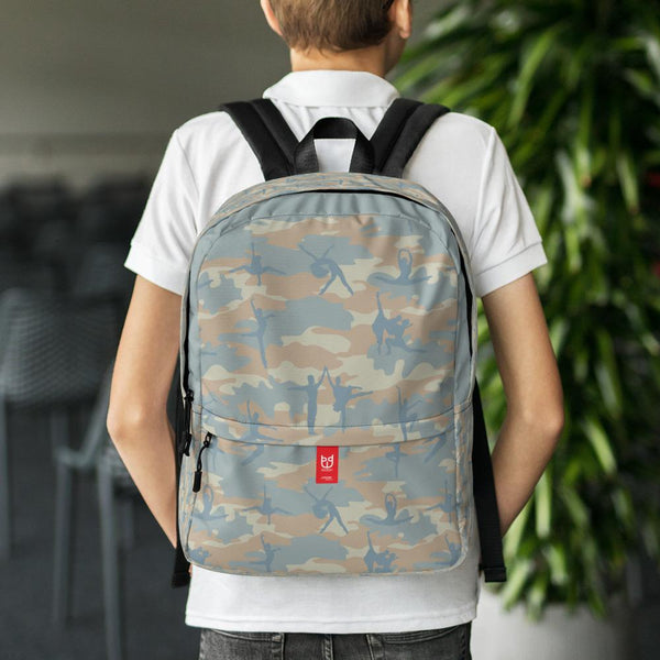 Boy model wearing Camo Backpack | Ballet | In Beige, Peach, and Pale Blue. Front view.
