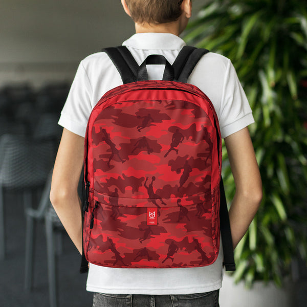 Boy wearing Camo Backpack | Basketball | In Reds. Front view.
