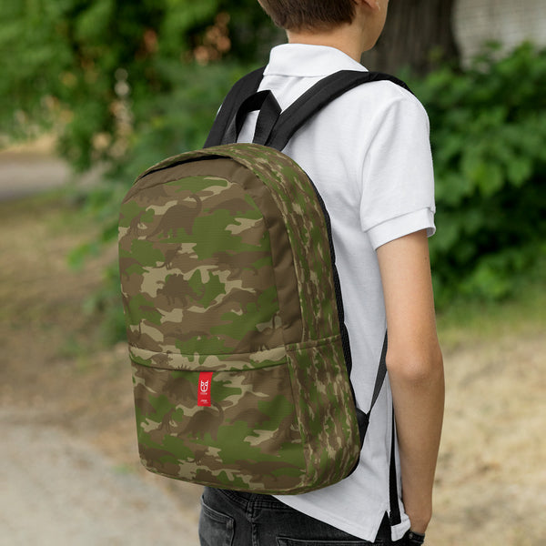 Boy model wearing Camo Backpack | Dinosaurs| In Browns and Green. 3/4 view.