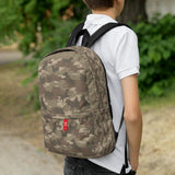 Camo Dogs Backpack In Browns. 3/4 view. Model shot.